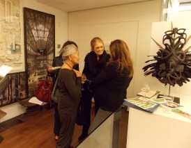 Gloria Steinem, center, talks with organizers and guests before the presentation.