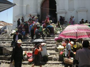 At Santo Tomas, a Catholic church built atop a Maya altar in Chichicastenango, worshipers use symbols of both cultures.  Photo by Barbara Borst