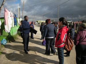 Caring Network members show students around Khayelitsha township. Photo by Barbara Borst